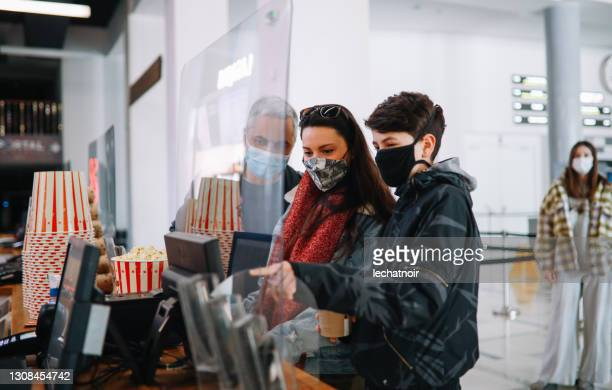 cinema reopens after the covid-19 pandemic - film premiere stock pictures, royalty-free photos & images