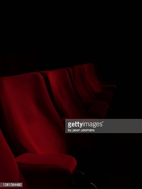 cinema seats - organised group stock pictures, royalty-free photos & images