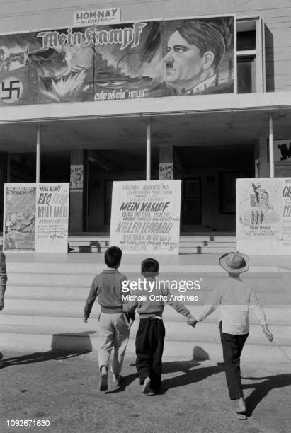 A cinema showing the films 'Mein Kampf' and 'Killer Leopard' in South Vietnam during the Vietnam War March 1962