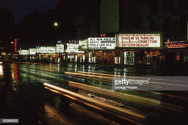 Cinema signs advertising adult and martial arts films on 42nd Street New York circa 1977