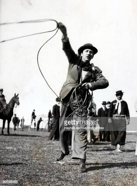 Cinema South America American animator Walt Disney the creator of Mickey Mouse twirls a gaucho's lasso during a visit to Argentina 1962