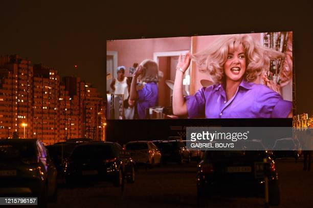 Cinemagoers in their cars attend a screening of the US musical romantic comedy film Grease during the reopening of the Autocine Madrid Race drivein...