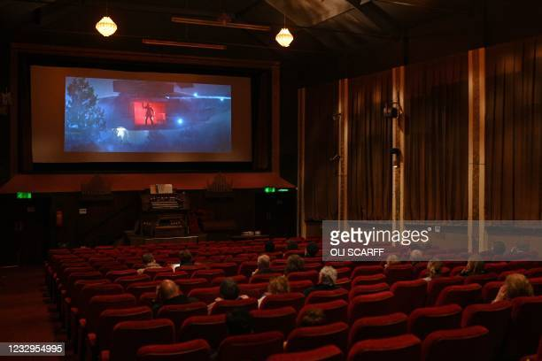 """Cinema-goers in their socially-distanced seats watch trailers before a showing of """"Nomadland"""" in the Rex cinema in Elland in northern England on May..."""