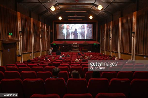 """Cinema-goers take their seats for a showing of """"Nomadland"""" in the Rex cinema in Elland in northern England on May 17 as Covid-19 lockdown..."""