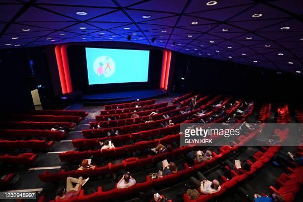Cinema-goers take their seats for the matinee showing in the BFI Southbank cinema in London on May 17 as Covid-19 lockdown restrictions ease.