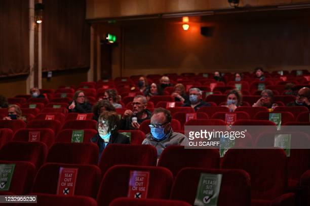 """Cinema-goers take their socially-distanced seats for a showing of """"Nomadland"""" in the Rex cinema in Elland in northern England on May 17 as Covid-19..."""