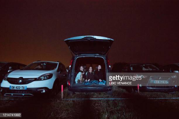 Cinemagoers watch a movie from their cars at a drivein theater in Les Herbiers western France on May 22 as France eases lockdown measures taken to...