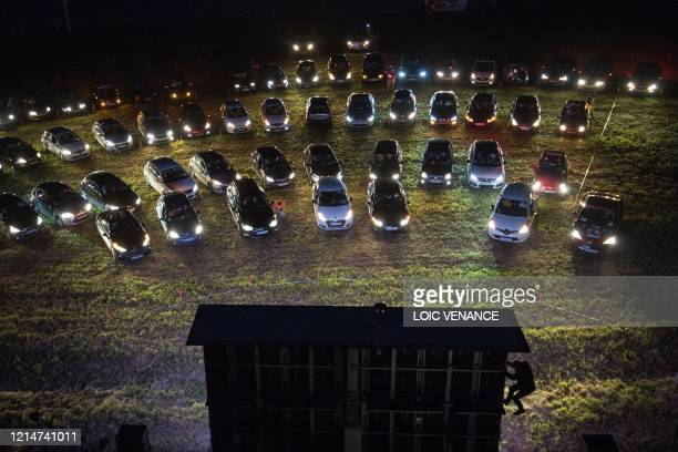 TOPSHOT Cinemagoers watch a movie from their cars at a drivein theater in Les Herbiers western France on May 22 as France eases lockdown measures...