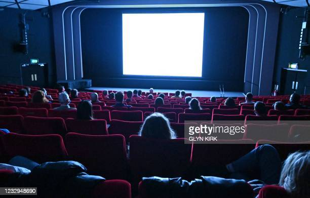 """Cinema-goers watch Ingmar Bergman's """"Persona"""" in the BFI Southbank cinema in London on May 17 as Covid-19 lockdown restrictions ease."""