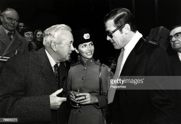 5th December 1976 Former Prime Minister Sir Harold Wilson left chats on the Pinewood Studios set of the new James Bond film 'The Spy Who Loved Me'to...