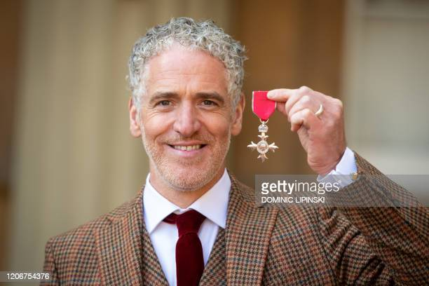 Cinematographer and Presenter GordonBuchanan poses with his medal after being appointed a Member of the Most Excellent Order of the British Empire...