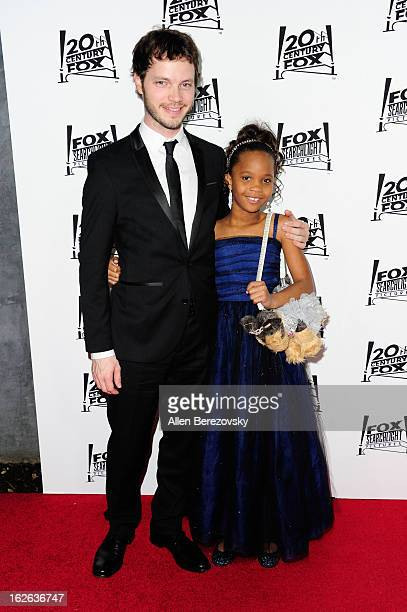 Cinematographer Ben Richardson and actress Quvenzhane Wallis attend the 20th Century FOX and FOX Searchlight Academy Award Nominees Party at Lure on...