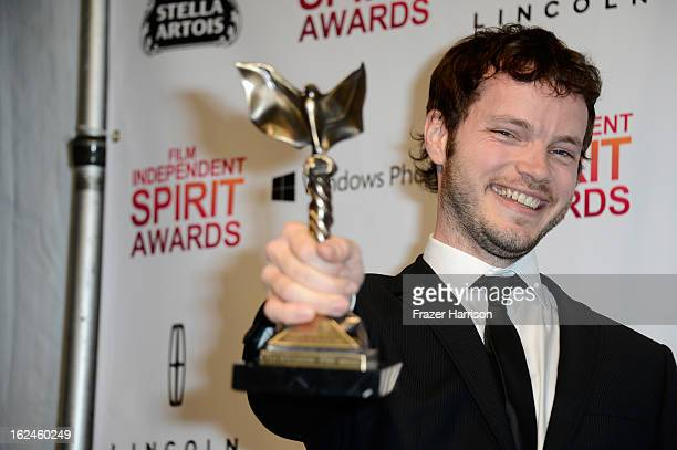 Cinematographer Ben Richardson poses with the award for Best Cinematography in the press room during the 2013 Film Independent Spirit Awards at Santa...