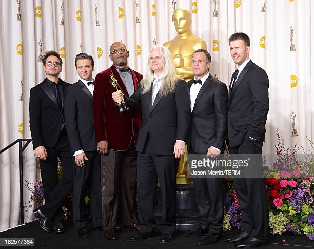 Cinematographer Claudio Miranda winner of the Best Cinematography award for Life of Pi with presenters Robert Downey Jr Jeremy Renner Samuel L...