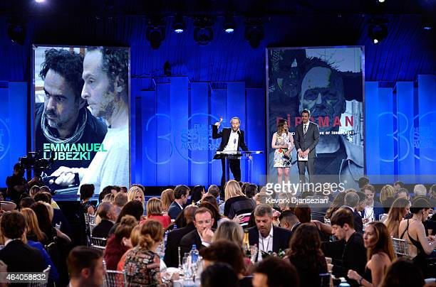 Cinematographer Emmanuel Lubezki accepts Best Cinematography for 'Birdman' from actors Gillian Jacobs and Dax Shepard onstage during the 2015 Film...
