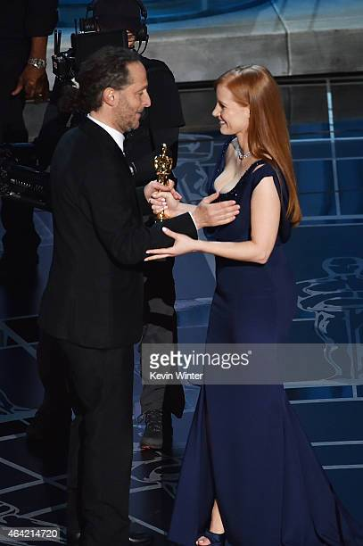Cinematographer Emmanuel Lubezki accepts Best Cinematography for 'Birdman' from actress Jessica Chastain onstage during the 87th Annual Academy...