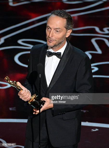 Cinematographer Emmanuel Lubezki accepts the Best Achievement in Cinematography award for 'Gravity' onstage during the Oscars at the Dolby Theatre on...