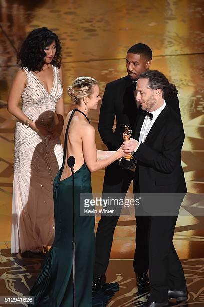 Cinematographer Emmanuel Lubezki accepts the Best Cinematography award for 'The Revenant' from actors Rachel McAdams and Michael B. Jordan onstage...