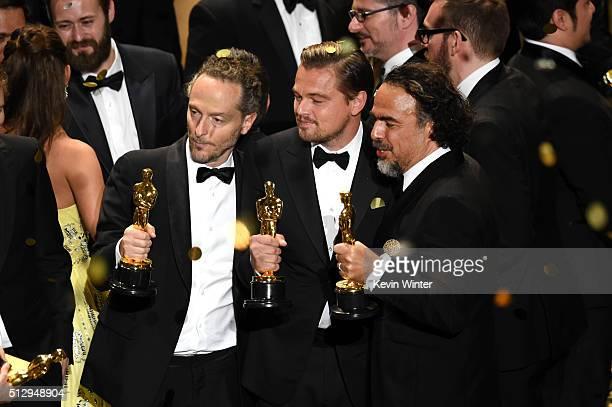 Cinematographer Emmanuel Lubezki, actor Leonardo DiCaprio and director Alejandro Gonzalez Inarritu, all winners for 'The Revenant,' pose onstage...