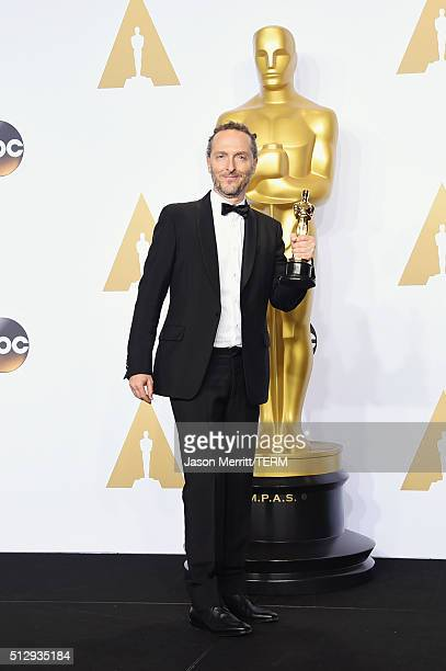 Cinematographer Emmanuel Lubezki, winner of Best Cinematography for 'The Revenant,' poses in the press room during the 88th Annual Academy Awards at...