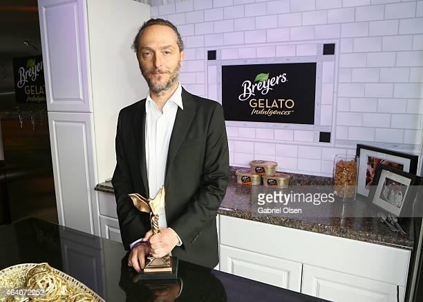Cinematographer Emmanuel Lubezki, winner of the Best Cinematography Award for 'Birdman,' stopped by the Breyers Gelato Indulgences Lounge backstage...