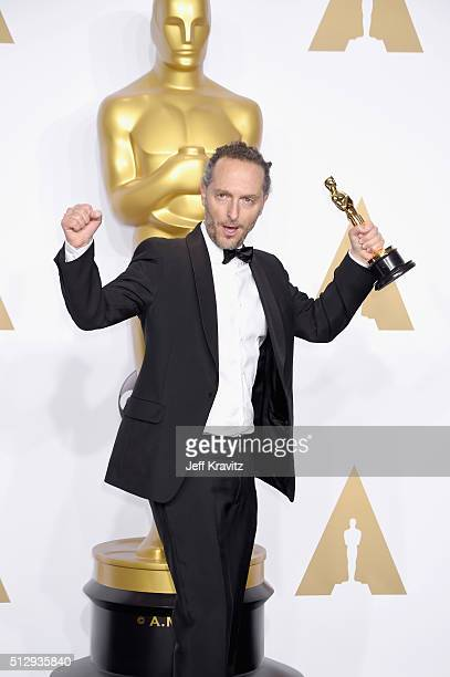 """Cinematographer Emmanuel Lubezki, winner of the Best Cinematography award for """"The Revenant,"""" poses in the press room during the 88th Annual Academy..."""