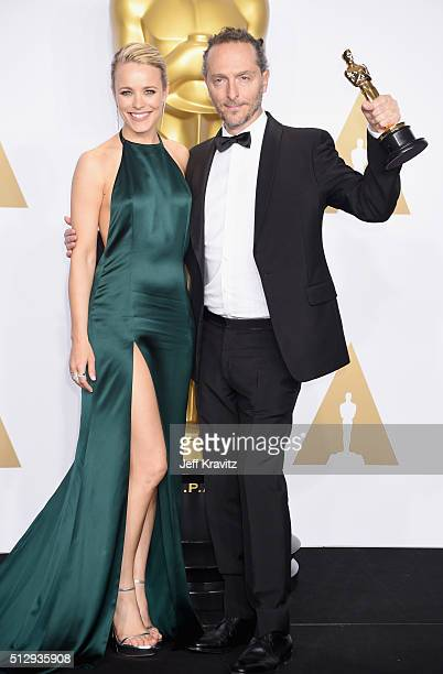 """Cinematographer Emmanuel Lubezki , winner of the Best Cinematography award for """"The Revenant,"""" poses with actress Rachel McAdams in the press room..."""