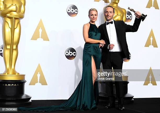 Cinematographer Emmanuel Lubezki, winner of the Best Cinematography award for 'The Revenant,' poses with actress Rachel McAdams in the press room...