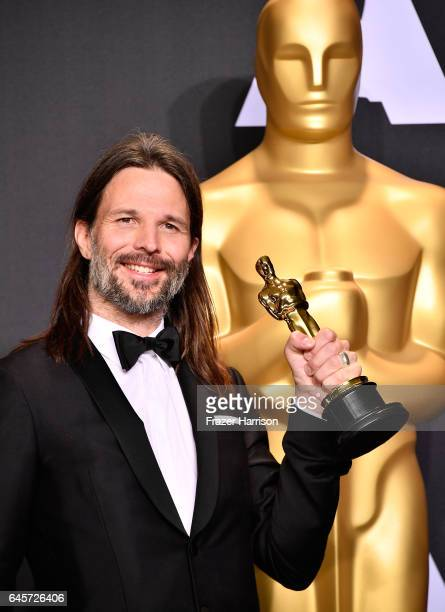 Cinematographer Linus Sandgren, winner of the Best Cinematography award for 'La La Land' poses in the press room during the 89th Annual Academy...