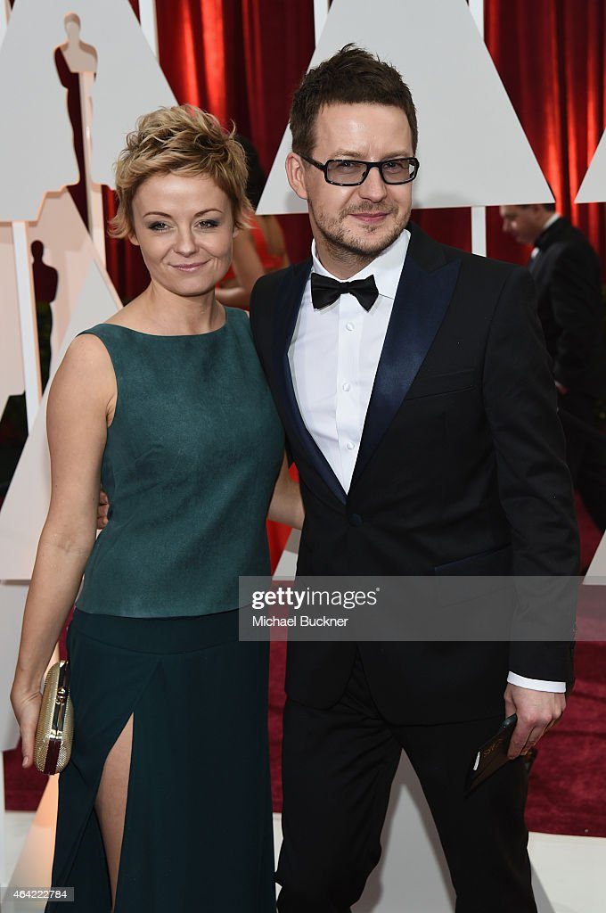Cinematographer Lukasz Zal (R) attends the 87th Annual Academy Awards at Hollywood & Highland Center on February 22, 2015 in Hollywood, California.