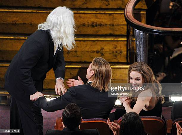 Cinematographer Robert Richardson, winner of the Best Cinematography Award, actor Brad Pitt and actress Angelina Jolie attend the 84th Annual Academy...