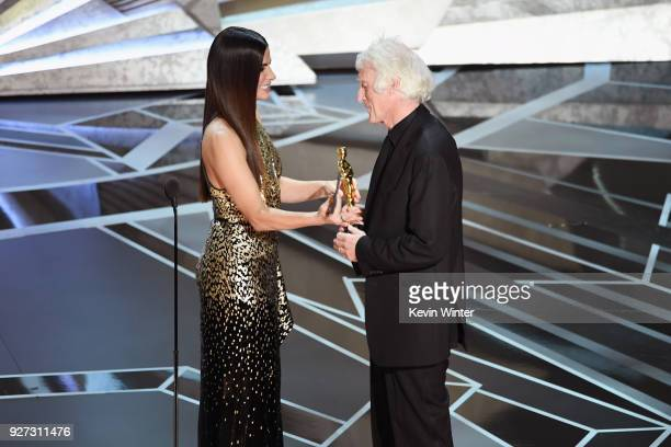 Cinematographer Roger A Deakins accepts Best Cinematography for 'Blade Runner 2049' from actor Sandra Bullock onstage during the 90th Annual Academy...