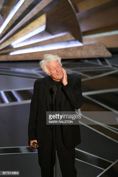 """Cinematographer Roger A. Deakins delivers a speech after he won the Oscar for Best Cinematography for """"Blade Runner 2049"""" during the 90th Annual..."""