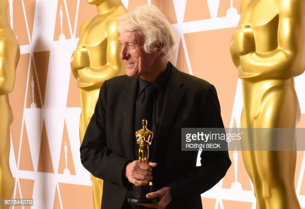 """Cinematographer Roger A. Deakins poses in the press room with the Oscar for Best Cinematography for """"Blade Runner 2049"""" during the 90th Annual..."""