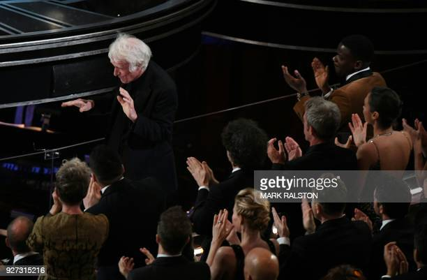 """Cinematographer Roger A. Deakins reacts after he won the Oscar for Best Cinematography for """"Blade Runner 2049"""" during the 90th Annual Academy Awards..."""