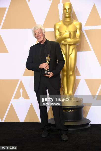Cinematographer Roger Deakins, winner of the Best Cinematography award for 'Blade Runner 2049,' poses in the press room during the 90th Annual...