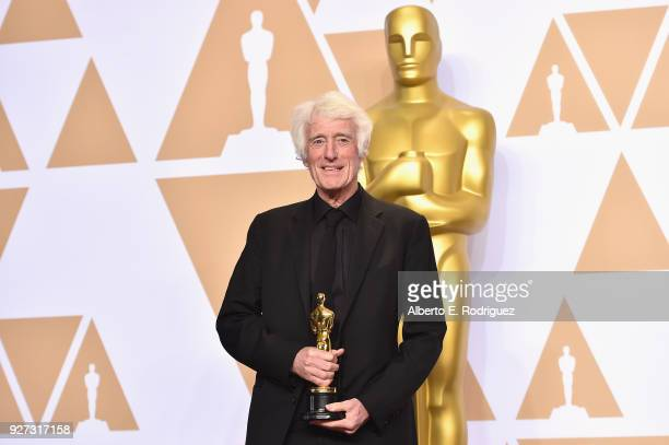 Cinematographer Roger Deakins winner of the Best Cinematography for Blade Runner poses in the press room during the 90th Annual Academy Awards at...