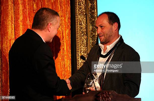 Cinematographer Seamus McGarvey accepts Oscar Wilde award from host/author Colum McCann onstage during the 5th Annual 'Oscar Wilde Honoring The Irish...