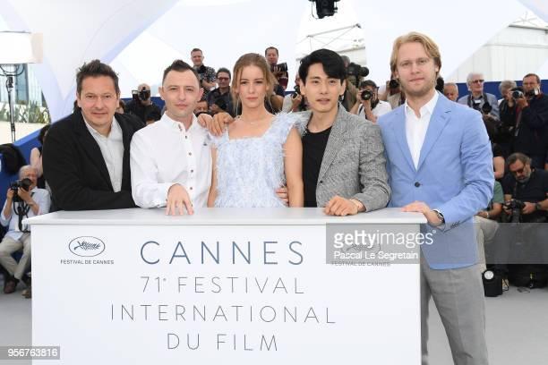 Cinematographer Vladislav Opelyants actor Roman Zver actress Irina Starshenbaum actor Teo Yoo and producer Ilya Stewart attends the photocall for...