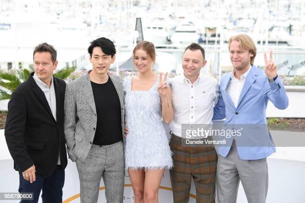 Cinematographer Vladislav Opelyants actor Teo Yoo actress Irina Starshenbaum actor Roman Zver and director Ilya Stewart give the thumbs up as they...
