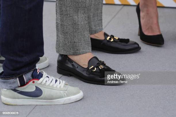 Cinematographer Vladislav Opelyants actor Teo Yoo and actress Irina Starshenbaum shoe details attend the photocall for Leto during the 71st annual...