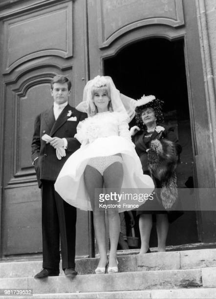 Cinematographic wedding between JeanPierre HONORE and Catherine DENEUVE whose dress is raised by a gutsy wind in the film LE VICE ET LA VERTU by...