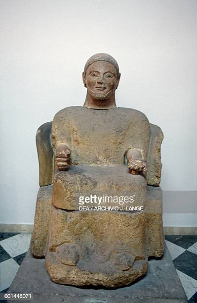 Cinerary statue with male figure sitting from Chiusi Tuscany Italy Etruscan civilisation 6th century BC Palermo Museo Archeologico Regionale