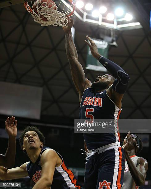 Cinmeon Bowers of the Auburn Tigers dunks the ball against the New Mexico Lobos at the Stan Sheriff Center during the Diamond Head Classic on...
