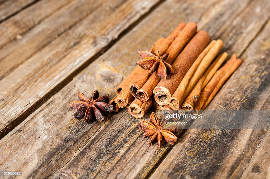 Cinnamon and anise on wooden background : Stock Photo