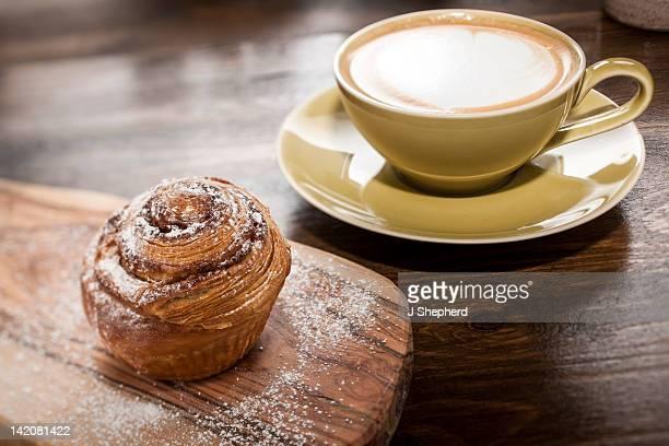 Cinnamon brioche with latte coffee
