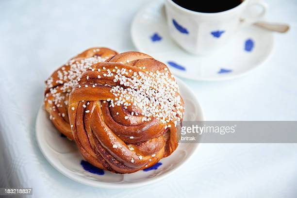 Cinnamon bun with cup of coffee.