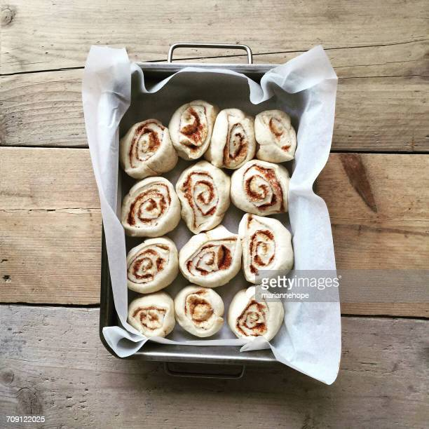 cinnamon buns in a baking tray - taken on mobile device stock photos and pictures