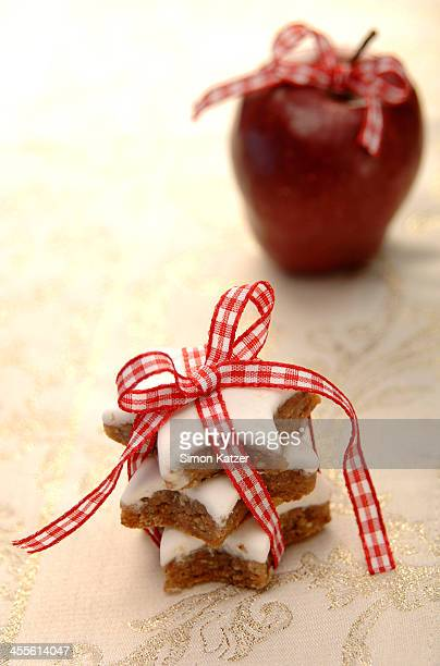 Cinnamon cookies and red apple with bow