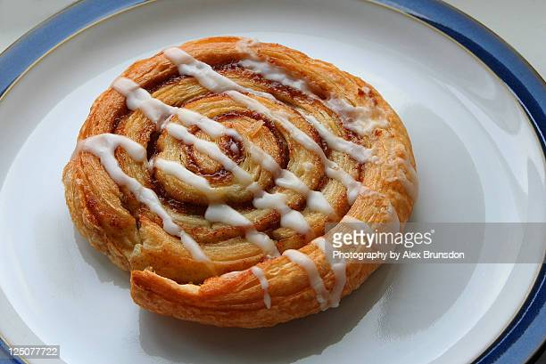 cinnamon danish pastry with icing - danish culture stock pictures, royalty-free photos & images